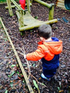 COLLECTING STICKS FOR DEN BUILDING